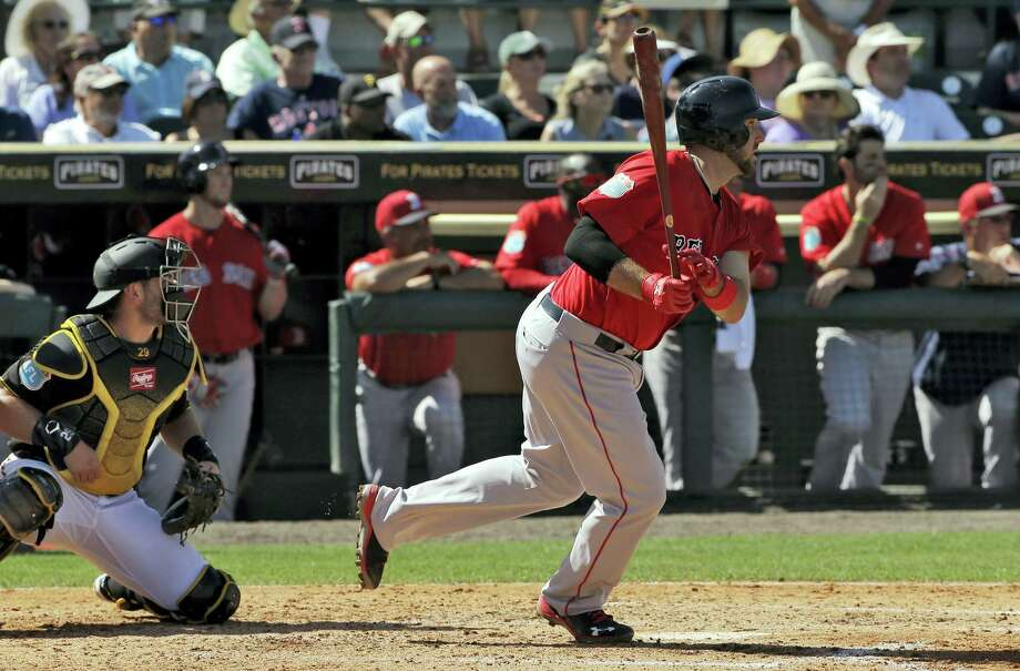 Boston Red Sox's Travis Shaw lines an RBI single off Pittsburgh Pirates relief pitcher Jared Hughes during the fifth inning of a spring training baseball game Wednesday, March 9, 2016, in Bradenton, Fla. Catching for the Pirates is Francisco Cervelli. (AP Photo/Chris O'Meara) Photo: AP / AP