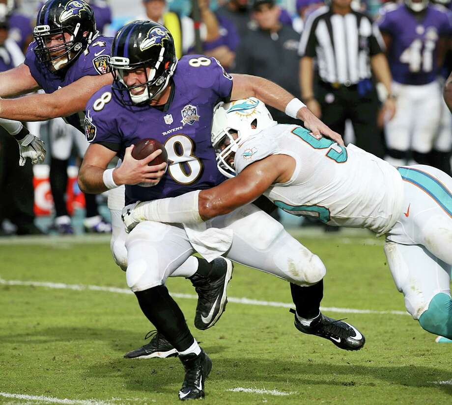 FILE - In this Dec. 6, 2015, file photo, Baltimore Ravens quarterback Matt Schaub (8) is sacked by Miami Dolphins defensive end Olivier Vernon (50), during the second half of an NFL football game, in Miami Gardens, Fla. Defensive end Olivier Vernon's transition tag has been removed by the Dolphins, allowing him to become a free agent hours after the team signed Mario Williams as a replacement. The transition tag was for $12.734 million, but the Dolphins withdrew the offer Wednesday, March 9, 2016, making it likely Vernon will depart after four seasons in Miami. (AP Photo/Wilfredo Lee, File) Photo: AP / AP