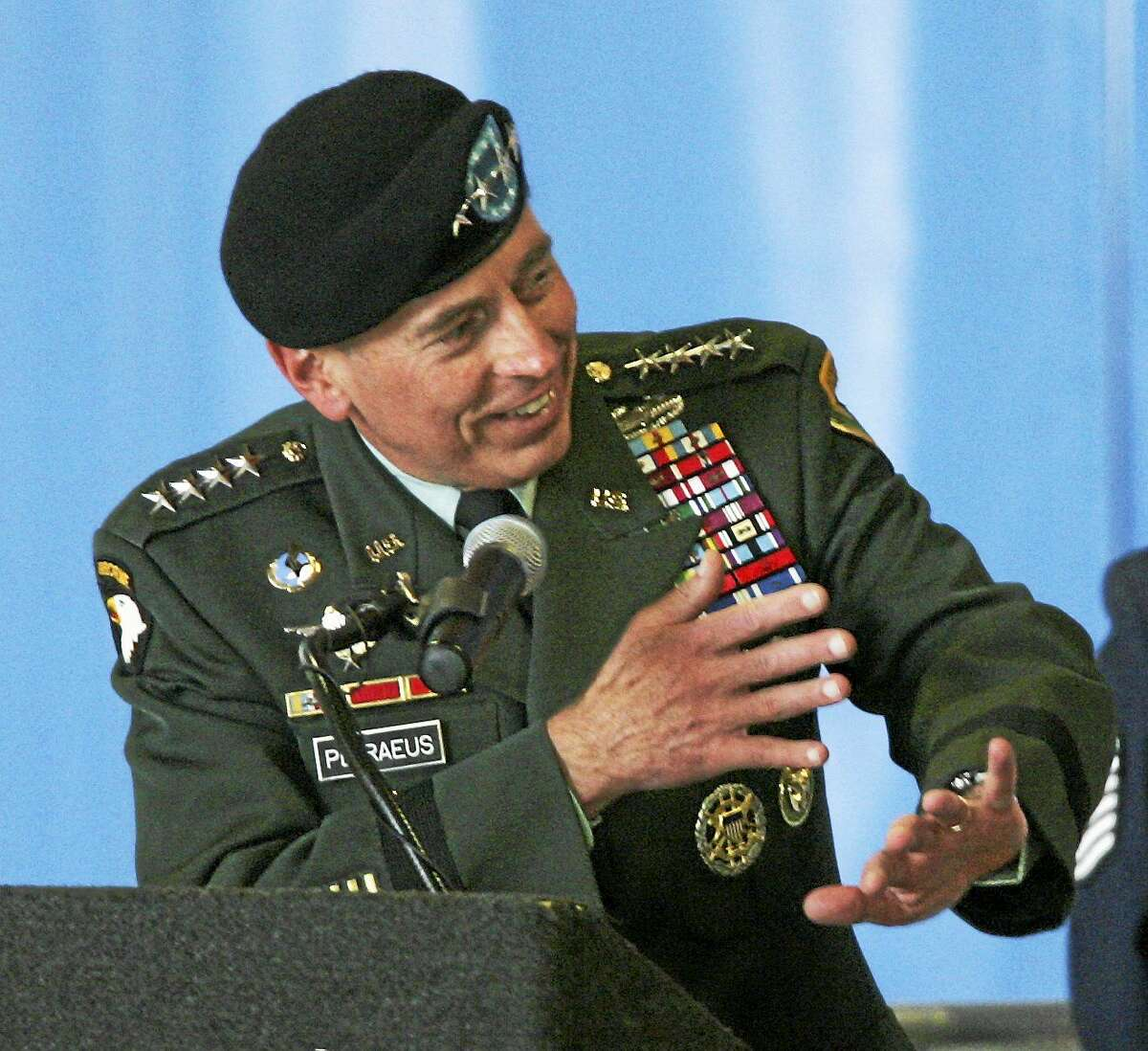 Then-Army Gen David Patraeus gestures as he talks about an old combat story with outgoing Ninth Air Force and U.S. Air Force Central Commander Lt. Gen Gary L. North during change of command ceremonies on Aug. 5, 2009, at Shaw Air Force Base in Sumter, S.C.