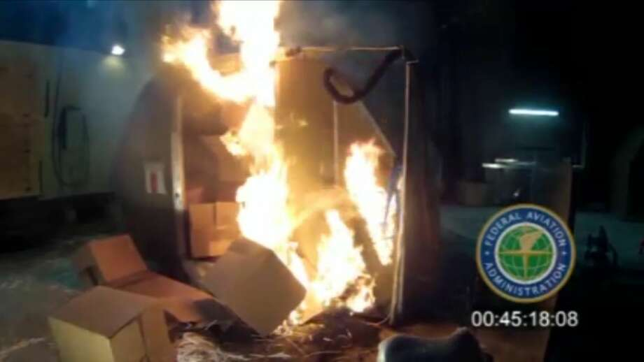 File-This file frame grab from video, provided by the Federal Aviation Administration (FAA) shows a test at the FAAs technical center in Atlantic City, N.J. last April, where a cargo container was packed with 5,000 rechargeable lithium-ion batteries. Citing safety concerns, United Airlines on Monday, March, 2, 2015, became the second major U.S. airline to announce it will no longer accept bulk shipments of rechargeable batteries of the kind that power everything from smartphones to laptops to power tools. (AP Photo/FAA, File) Photo: AP / FAA