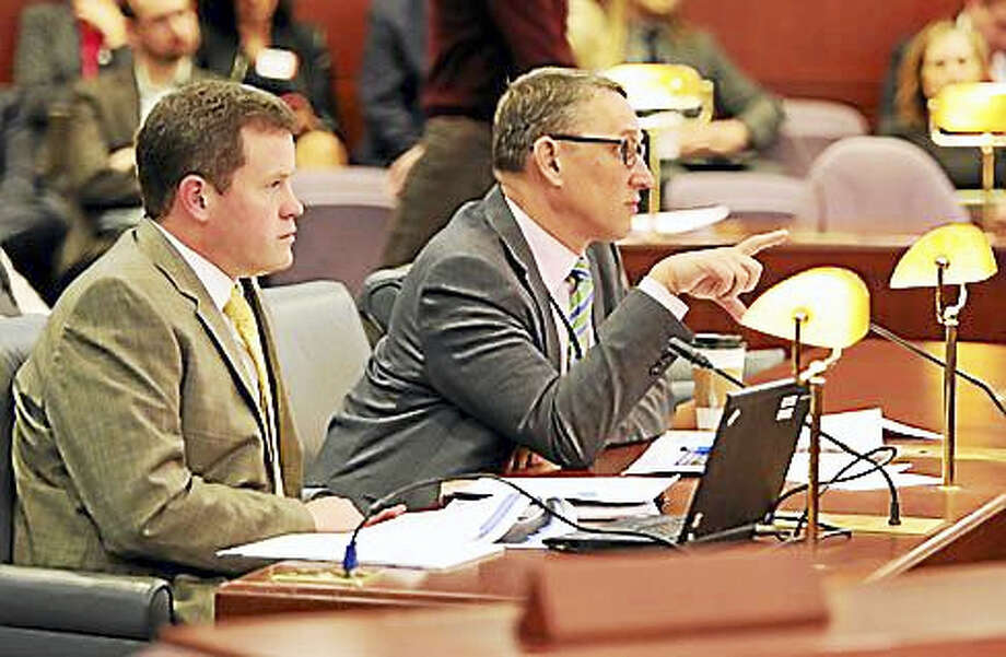 Office of Fiscal Analysis Director Neil Ayers, left, and OPM Secretary Ben Barnes speak Wednesday to members of the Appropriations and Finance, Revenue and Bonding committees in the Legislative Office Building in Hartford. Photo: Christine Stuart — CT News Junkie