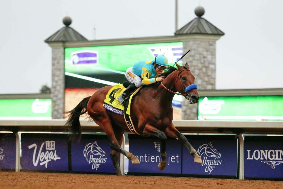American Pharoah, with Victor Espinoza up, won the Breeders' Cup Classic Saturday at Keeneland race track in Lexington, Ky. Photo: The Associated Press  / AP