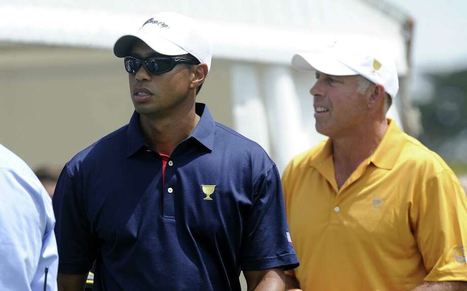 Tiger Woods, left, and his former caddie Steve Williams. Photo: The Associated Press File Photo  / AP