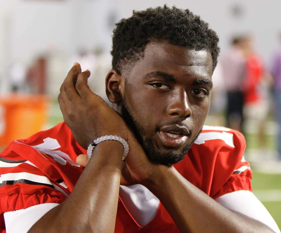Quarterback J.T. Barrett and Ohio State remain No. 1 in the latest AP college football Top 25 poll. Photo: The Associated Press File Photo  / FR66830 AP