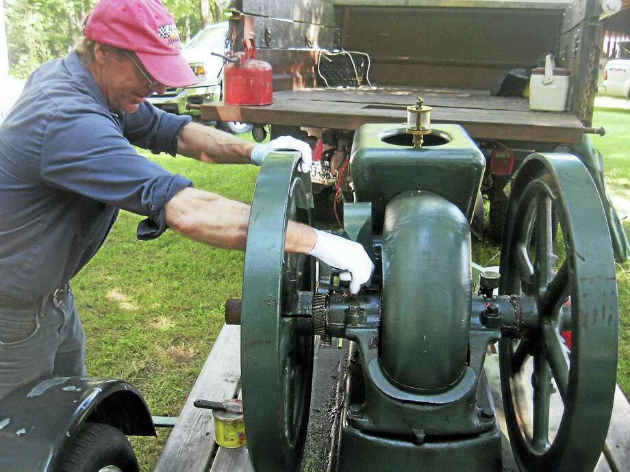 Photo by JOHN TORSIELLO Dave Weide attends to his Fairbanks Morse Model 2 engine. Photo: Journal Register Co.