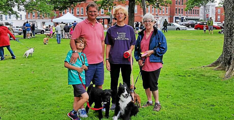 """Sebastian Arnold, 7; his father Nick Arnold; wife Margaret Arnold; and Ms. Arnold's aunt Anne Ranson of New Milford showed off Ranson's canine recipients of the """"Senior Dog"""" ribbon, Jata and Lila, both 14, at the Litchfield Historical Society's annual Pet Parade and Turn-of-the-Century Fest on the Litchfield Town Green on Saturday afternoon. Photo: NF Ambery--Special To The Register Citizen"""