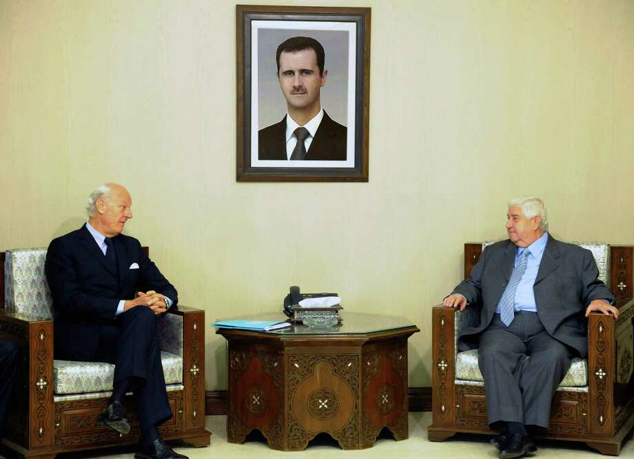 In this photo released by the Syrian official news agency SANA, Syria's Foreign Minister Walid al-Moallem, right, meets with U.N. Special Envoy for Syria Staffan de Mistura in Damascus, Syria on Nov. 1, 2015. Photo: SANA Via AP  / SANA