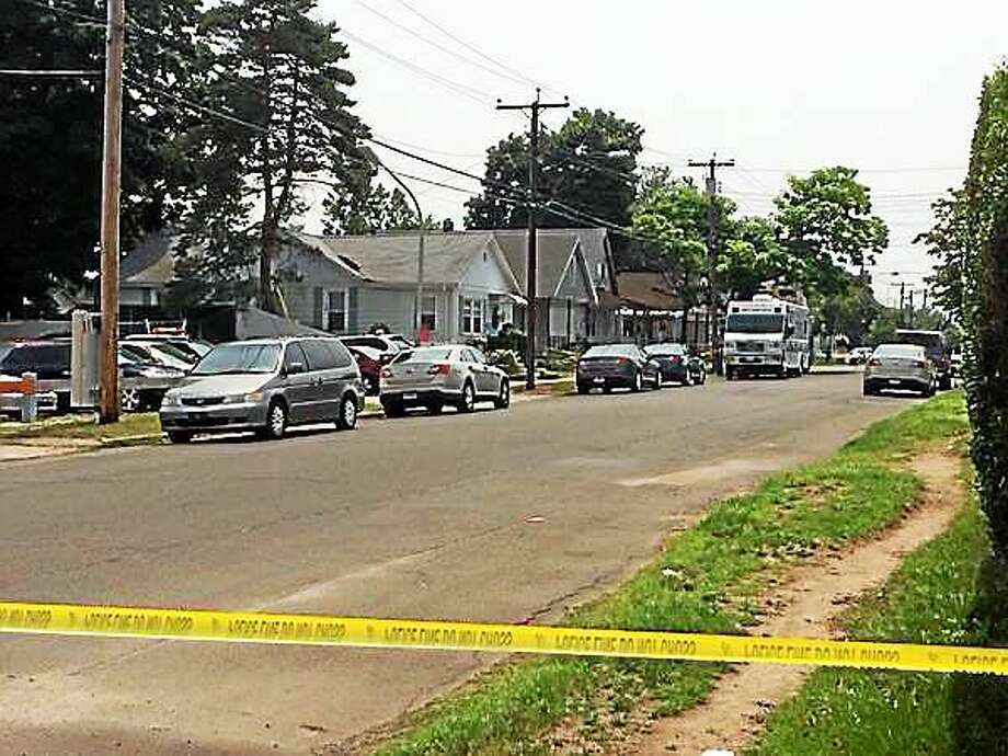 Police executed a search and seizure warrant at 59 Front Ave. Monday in connection with the explosion and dead body found in Hamden over the weekend. Photo: Wes Duplantier/New Haven Register