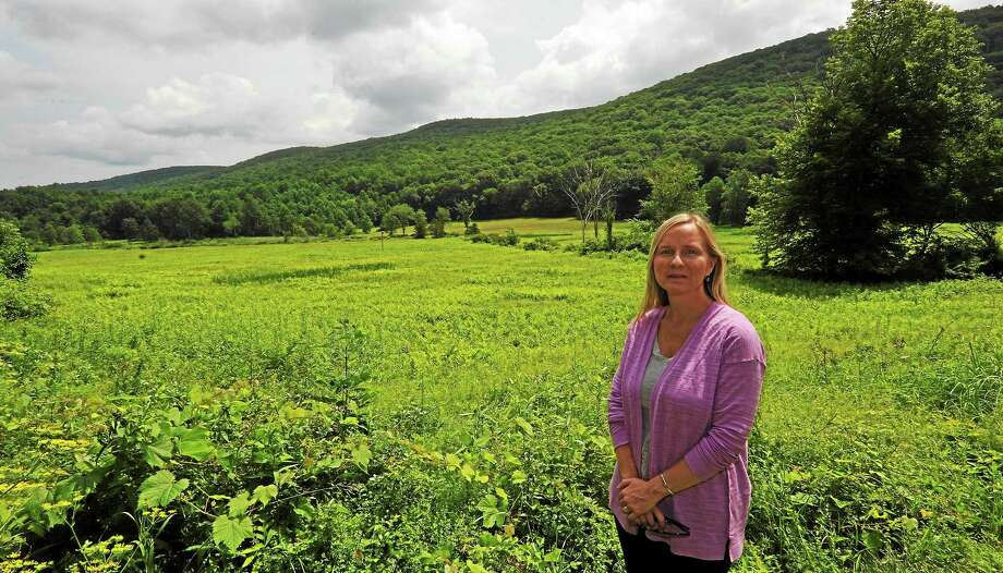 JOHN FITTS — THE REGISTER CITIZEN Weantinoge Heritage Land Trust Executive Director Catherine M. Rawson at Cobble Brook Vista Preserve in Kent. Photo: Journal Register Co.