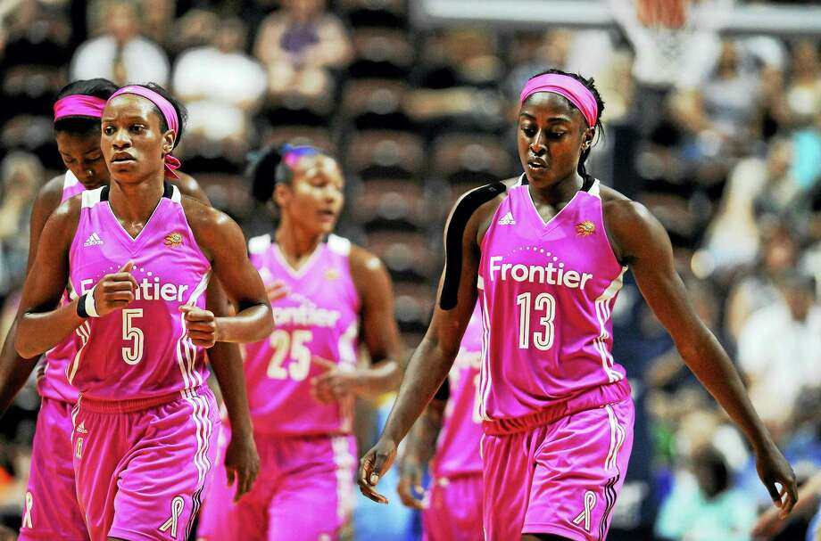 The Connecticut Sun's Jasmine Thomas, left, and Chiney Ogwumike, right, walk off the court during a game last season. Photo: The Associated Press File Photo  / AP2016