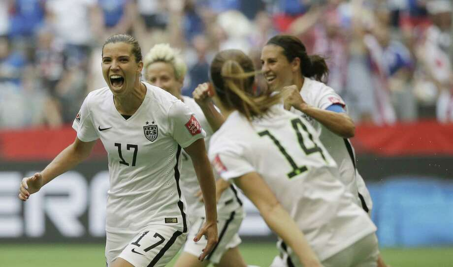 United States' Tobin Heath, left, celebrates after she scored a goal against Japan during the second half of the FIFA Women's World Cup soccer championship in Vancouver, British Columbia, Canada, Sunday, July 5, 2015. (AP Photo/Elaine Thompson) Photo: The Associated Press  / AP