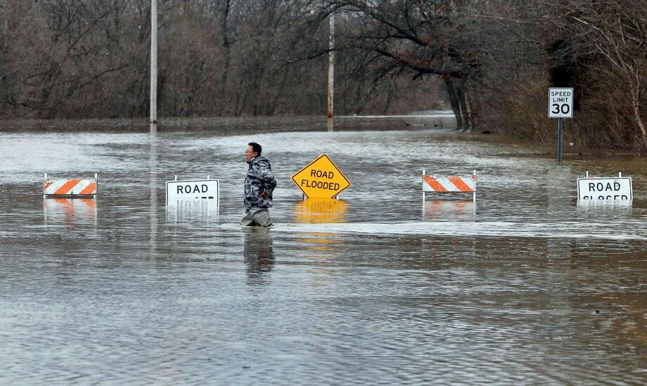 A man crosses Smizer Mill Road in southwest St. Louis County Wednesday. Photo: J.B. Forbes/St. Louis Post-Dispatch Via AP  / St. Louis Post-Dispatch