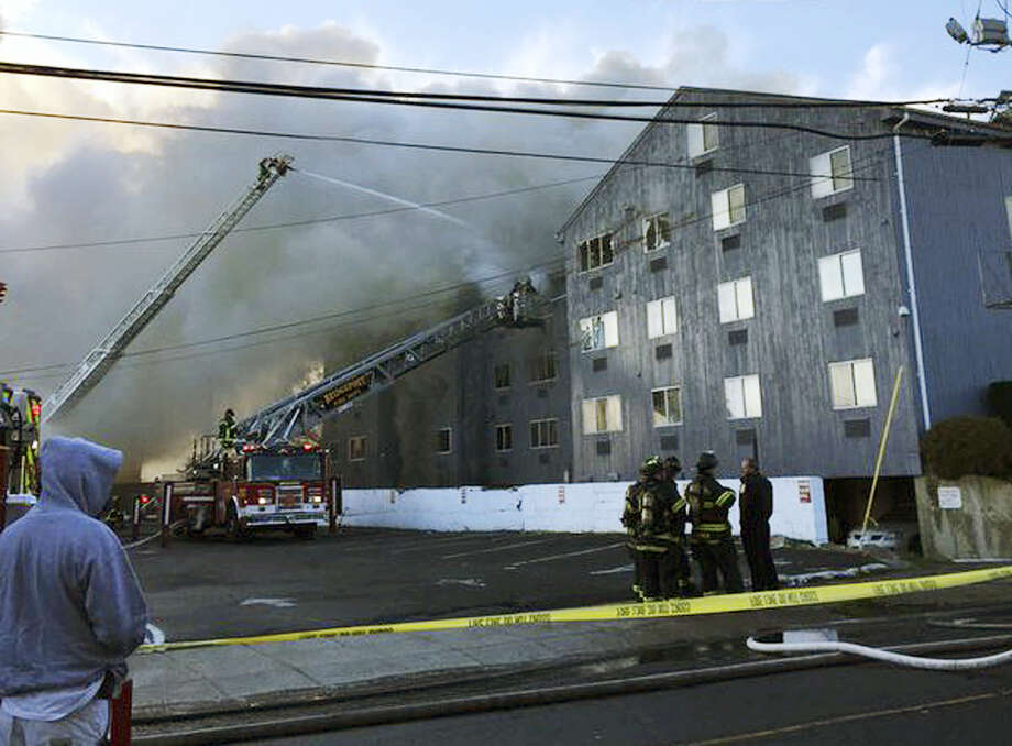 Firefighters battle a fire that destroyed a large apartment building on Charles Street in Bridgeport Thursday morning, Dec. 31, 2015. Bridgeport officials said the fire at the condominium left more than 100 people homeless. Photo: NBC Connecticut WVIT Via AP / NBC Connecticut WVIT