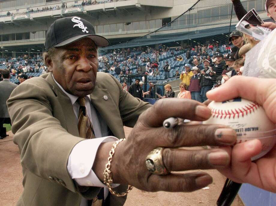 """In a April 6, 2001 photo, Chicago White Sox legend Orestes """"Minnie"""" Minoso signs autographs prior to the Sox' home opener against the Detroit Tigers, at Comiskey Park in Chicago. Photo: AP Photo/Ted S. Warren, File  / AP"""