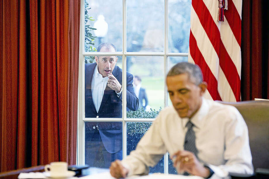 """Comedian Jerry Seinfeld knocks on the Oval Office window to begin a segment for his series, """"Comedians in Cars Getting Coffee."""" Photo: Official White House Photo By Pete Souza  / Official White House photo by Pete Souza"""