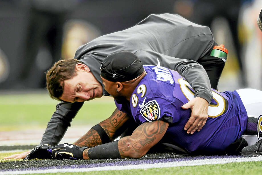 A trainer tends to Baltimore Ravens wide receiver Steve Smith after an injury during a Nov. 1 game. Photo: Gail Burton — The Associated Press File Photo  / FR4095 AP