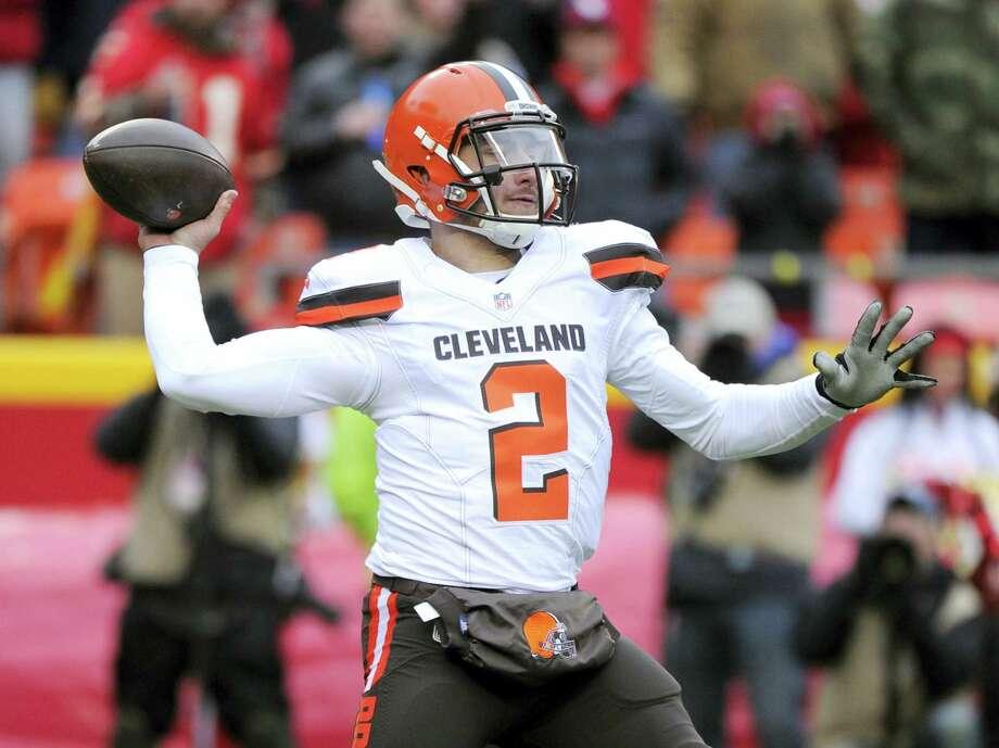 Cleveland Browns quarterback Johnny Manziel will likely miss Sunday's season finale. Photo: Ed Zurga — The Associated Press  / FR34145 AP