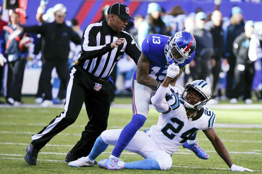 A referee separates New York Giants receiver Odell Beckham and Carolina Panthers cornerback Josh Norman during a Dec. 20 game in East Rutherford, N.J. Photo: Julie Jacobson — The Associated Press  / AP