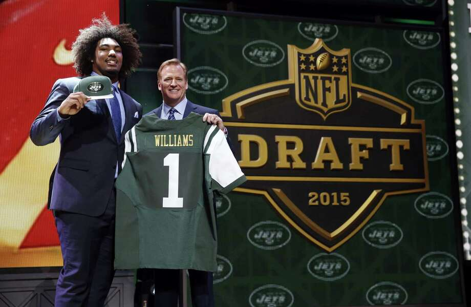 USC defensive lineman Leonard Williams poses for photos with NFL commissioner Roger Goodell after being selected by the New York Jets with the sixth pick on Thursday. Photo: The Associated Press  / AP