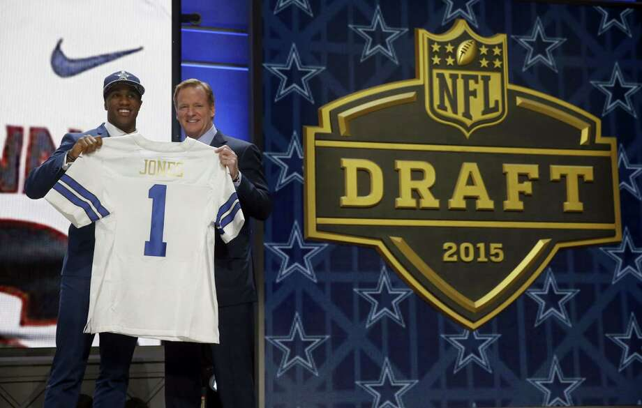 UConn defensive back Byron Jones poses for photos with NFL commissioner Roger Goodell after being selected by the Dallas Cowboys as the 27th pick on Thursday. Photo: The Associated Press  / AP