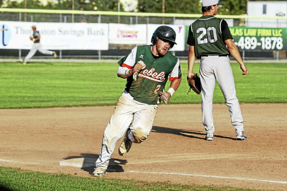 Torrington's Austin Patenaude scores on a double by Pepe Napoleon in a Tri-State Baseball Tournament first-round win over Bristol Thursday night at Fuessenich Park. Photo: Photo By Marianne Killackey  / 2015