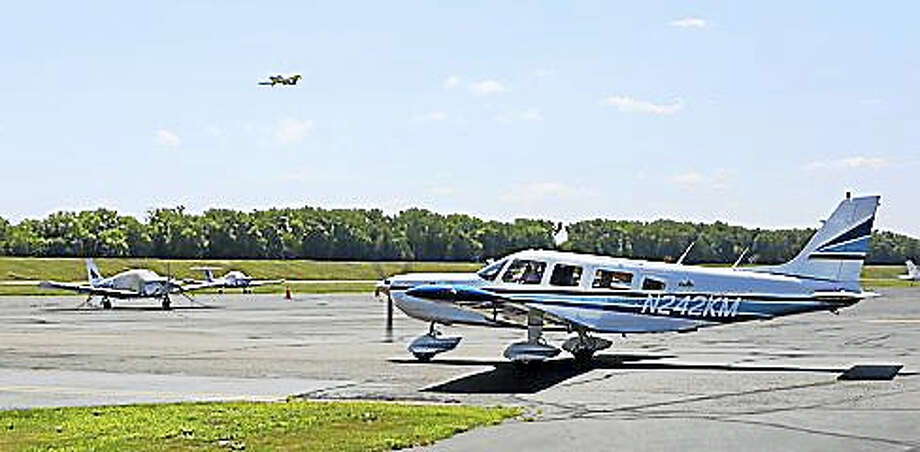A plane moves on the tarmac Thursday morning as another flight departs Brainard Airport in Hartford. Photo: Doug Hardy— CTNewsJunkie