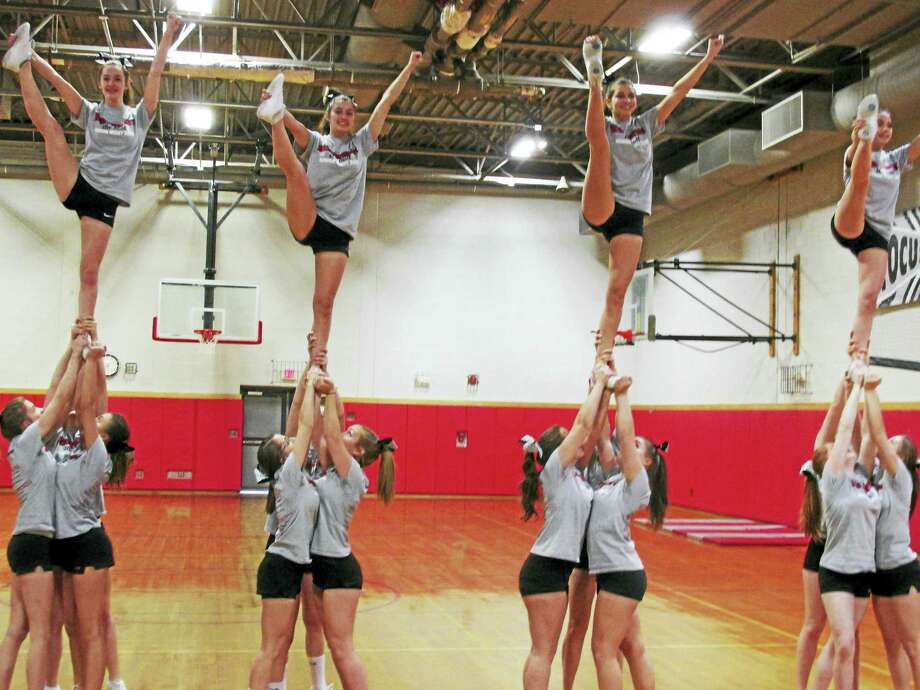 Northwestern's cheerleading team prepare for the New England Regionals after finishing third in the CIAC Class M Cheerling Tournament. Photo: Peter Wallace — The Register Citizen