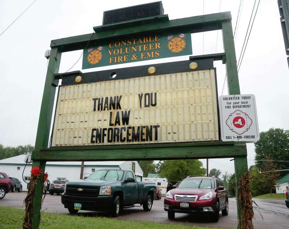 A sign at the Constable Volunteer Fire and EMS thanks law enforcement after the second of two escaped prisoners was apprehended on Sunday, June 28, 2015, in Constable, N.Y. David Sweat, the second of two convicted murderers who staged a brazen escape three weeks ago from a maximum-security prison in northern New York, was shot and captured near the Canadian border on Sunday, two days after his fellow inmate was killed in a confrontation with law enforcement officers, a sheriff said. (AP Photo/Mike Groll) Photo: AP / AP
