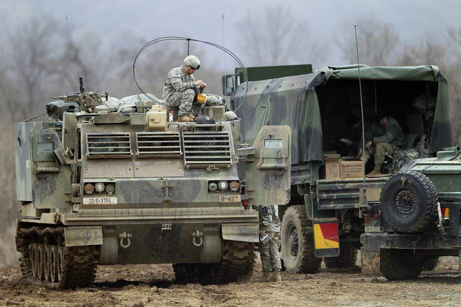 """A U.S. Army soldier sits on an armored vehicle during an annual exercise in Yeoncheon, near the border with North Korea, Monday, March 7, 2016. North Korea on Monday issued its latest belligerent threat, warning of an indiscriminate """"pre-emptive nuclear strike of justice"""" on Washington and Seoul, this time in reaction to the start of huge U.S.-South Korean military drills. Photo: AP Photo — Ahn Young-joon   / AP"""
