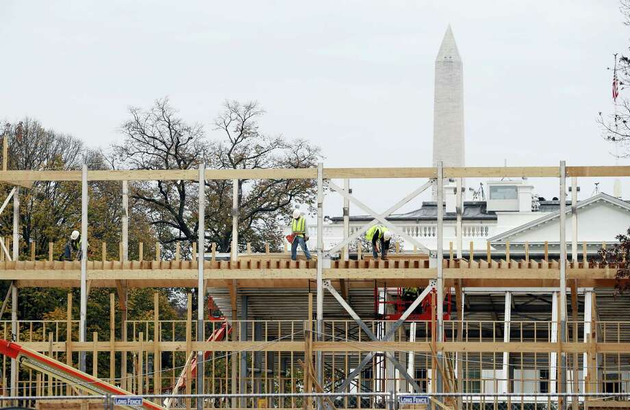 Construction continues on the presidential reviewing stand on Pennsylvania Avenue in Washington, Friday looking toward the White House and the Washington Monument. The reviewing stand is where then President Donald Trump will view the inaugural parade on. Photo: Alex Brandon — The Associated Press  / Copyright 2016 The Associated Press. All rights reserved.