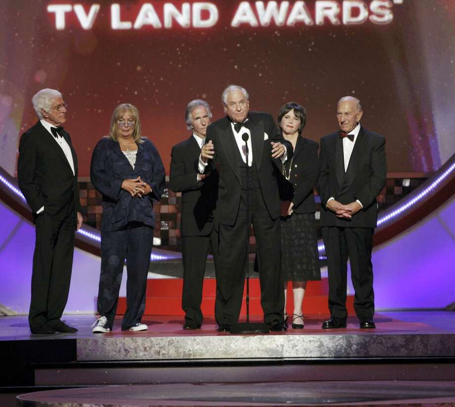 """In this June 8, 2008, file photo, producer Garry Marshall, center, accepts the legend award on stage at the TV Land Awards in Santa Monica, Calif. Writer-director Marshall, whose TV hits included """"Happy Days,"""" """"Laverne & Shirley"""" and box-office successes included """"Pretty Woman"""" and """"Runaway Bride,"""" has died at age 81. Publicist Michelle Bega says Marshall died Tuesday, July 19, 2016, in at a hospital in Burbank, Calif., of complications from pneumonia after having a stroke. Photo: AP Photo/Kevork Djansezian, File   / Copyright 2016 The Associated Press. All rights reserved. This material may not be published, broadcast, rewritten or redistribu"""