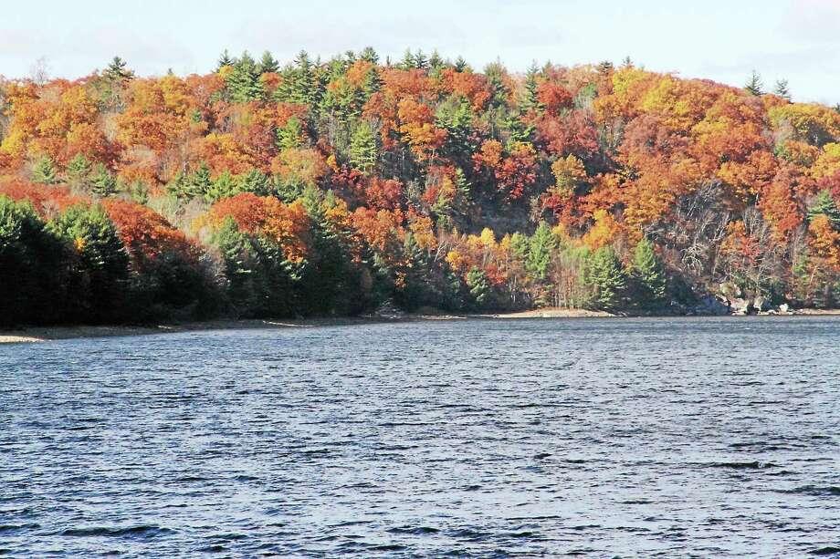 Fall foliage at Saville Dam and Farmington River in Barkhamsted. Photo: Register Citizen File Photo