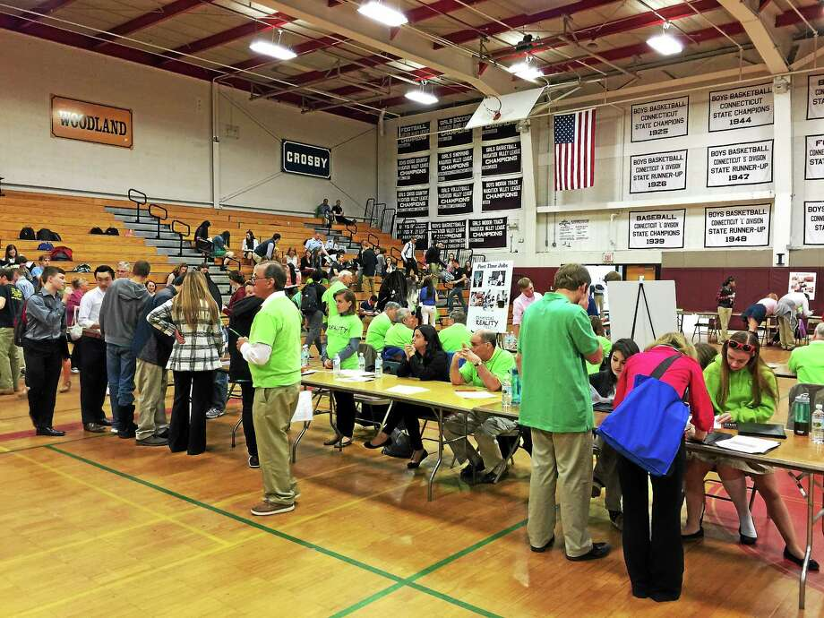 The 2015 iteration of the Financial Reality Fair, organized by Connecticut credit unions and the Northwest Connecticut Chamber of Commerce, was held Wednesday morning in the Torrington High School gymnasium. Photo: BEN LAMBERT — The Register Citizen