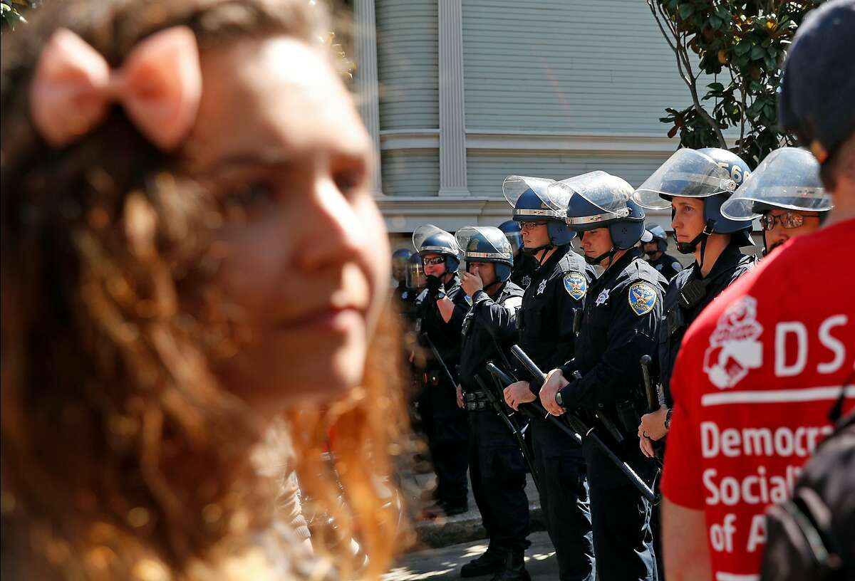 San Francisco Police create a line on Steiner Street outside of Alamo Square Park in San Francisco, Calif. on Saturday, August 26, 2017.
