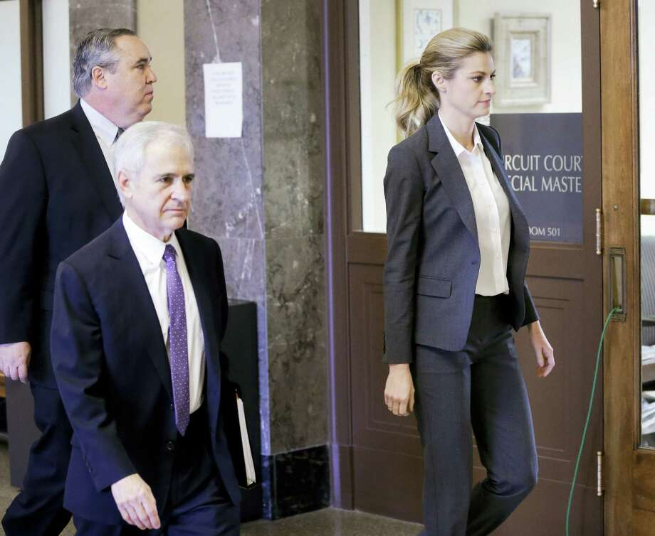 Sportscaster and television host Erin Andrews walks to the courtroom with attorneys Bruce Broillet, center, and Scott Carr, left, Monday in Nashville, Tenn. Photo: Mark Humphrey — The Associated Press  / AP