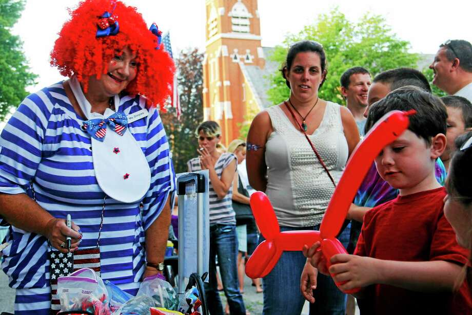 File photo - The Register Citizen  Dimples the Clown makes balloon animals during last year's Main Street Marketplace. Photo: Journal Register Co.