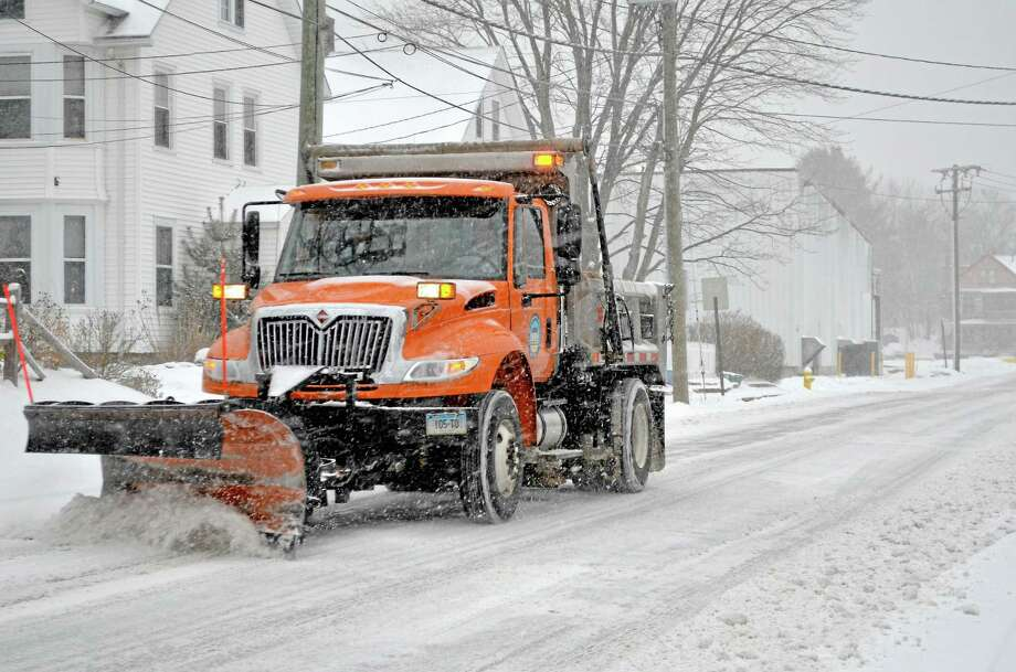 The city plow drivers were doing their best to keep the roads in Torrington clear Friday during a weekend snow storm in 2013. Photo: Register Citizen File Photo