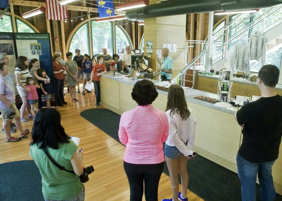 Visitors gather for a tour at Putnam Park in Redding for Family Day as part of the town's 250th anniversary. Saturday, Aug. 26, 2017 Photo: Scott Mullin / For Hearst Connecticut Media / The News-Times Freelance