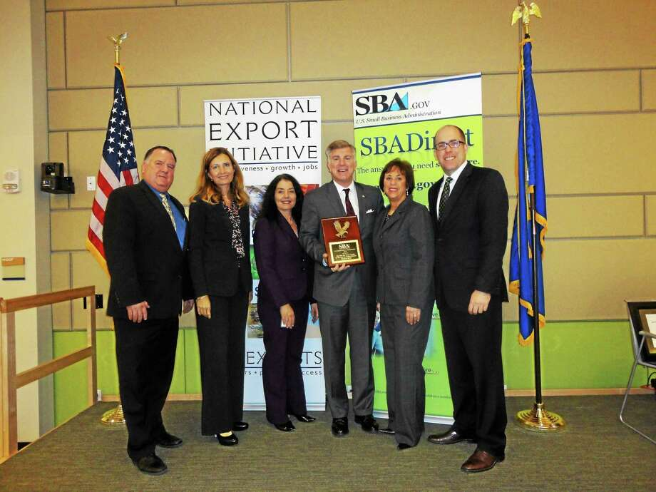 Above, from left, are Robert H. Nelson, acting SBA district director for Connecticut; Annette Larabee, senior vice president, business banking at Webster; Holly Campo de la Vera, vice president, SBA relations manager at Webster; Bob Polito; and Joanne L. Miller, vice president. Photo: Contributed Photo