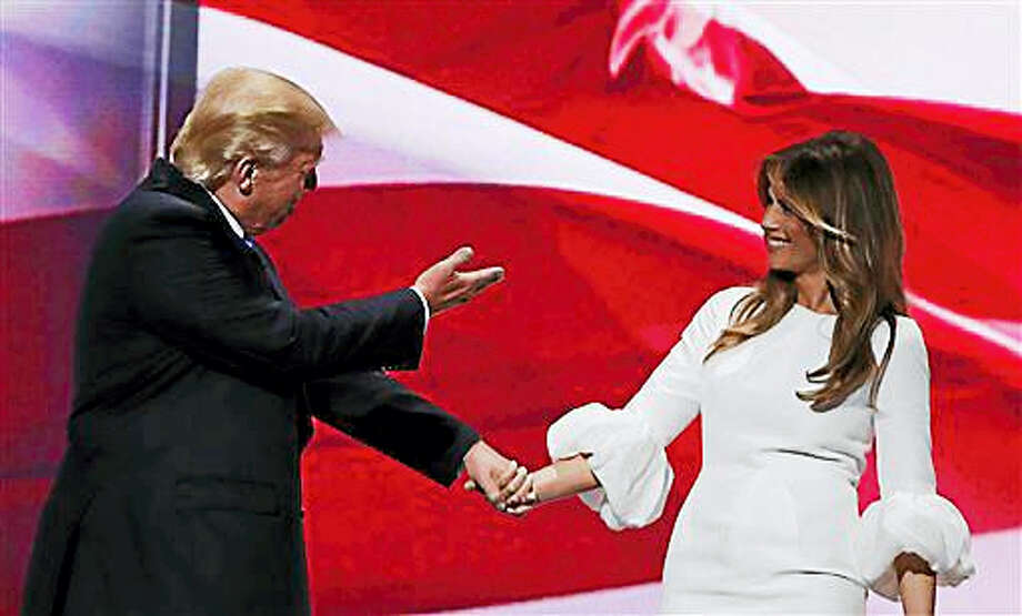 Republican presidential candidate Donald Trump, right, acknowledges his wife, Melania, as they walk off stage during the Republican National Convention, Monday, July 18, 2016, in Cleveland. Photo: AP Photo/Carolyn Kaster   / AP