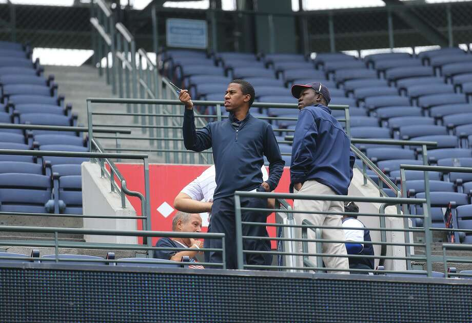 Atlanta Braves employees stand at the portal of section 401 near where fan Gregory K. Murrey, 60, Alpharetta, Ga., fell from the top deck to his death during Saturday's game between the Braves and Yankees. Photo: The Associated Press  / Atlanta Journal Constitution