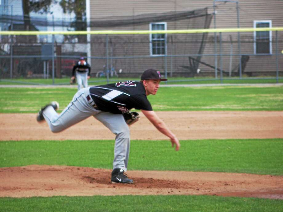 PETER WALLACE - register citizen Torrington sophomore Tyler Troth went six strong innings for the Red Raiders, but took Torrington's first loss Monday at Fuessenich Park. Photo: Journal Register Co.