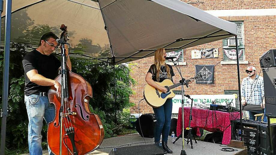 N.F. Ambery photo Tracy Walton and Julia Autumn Ford of the duo Belle of the Fall did a set at Fuse Fest Sunday afternoon. Photo: Journal Register Co.