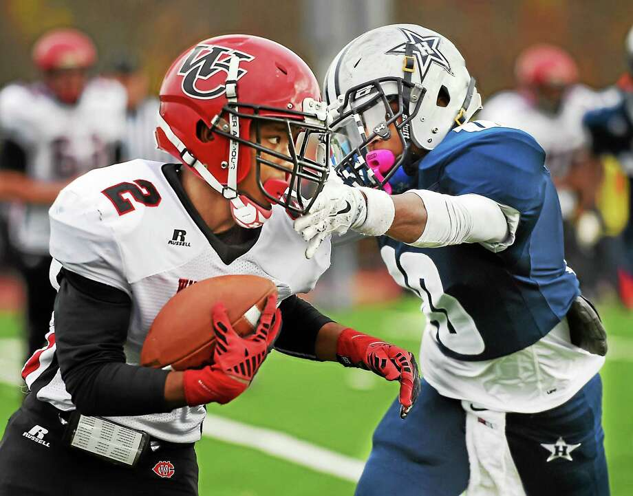 Wilbur Cross' Will Simmons looks for an opening as Hillhouse's Teron Mallory as the Academics defeat the Wilbur Cross Governors, 40-20, in the Elm City Bowl on Thanksgiving Day, November 26, 2015, at the newly renovated Bowen Field in New Haven. (Catherine Avalone/New Haven Register) Photo: Journal Register Co. / Catherine Avalone/New Haven Register