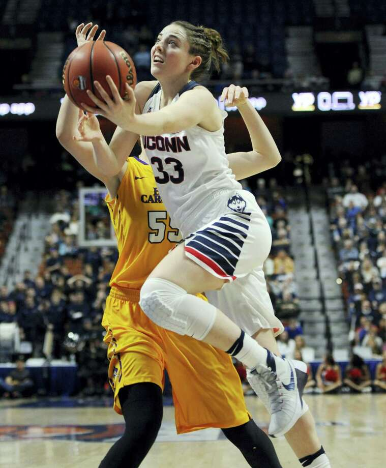 UConn's Katie Lou Samuelson drives to the basket around East Carolina's Marina Laramie during the first half Saturday. Photo: Jessica Hill — The Associated Press  / FR125654 AP