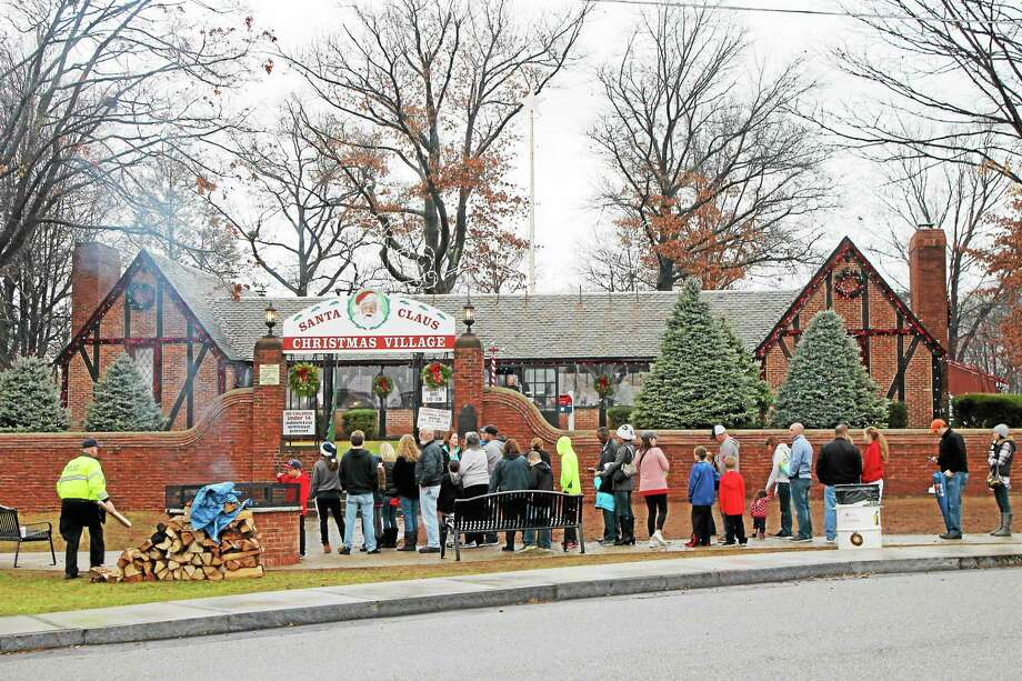 People were lining up at least an hour and 15 minutes before the Christmas Village opened in Torrington on Christmas Eve. Photo: Photo By John Nestor