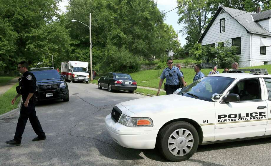 Kansas City, Kan., and Shawnee police officers work part of the shooting scene of a police officer in Kansas City, Kan. on Tuesday. A suspect in a drive-by shooting fatally shot Capt. Robert Melton, a 17-year veteran of the Kansas City, Kan. Police Department as the officer was sitting in his patrol car, police said. Photo: AP Photo — Orlin Wagner / Copyright 2016 The Associated Press. All rights reserved. This material may not be published, broadcast, rewritten or redistribu