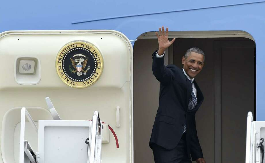 President Barack Obama waves from the top of the steps of Air Force One at Andrews Air Force Base in Md. on Aug. 31, 2015. Obama is traveling on a three-day trip to Alaska aimed at showing solidarity with a state often overlooked by Washington, while using its glorious but changing landscape as an urgent call to action on climate change. Photo: AP Photo/Susan Walsh  / AP