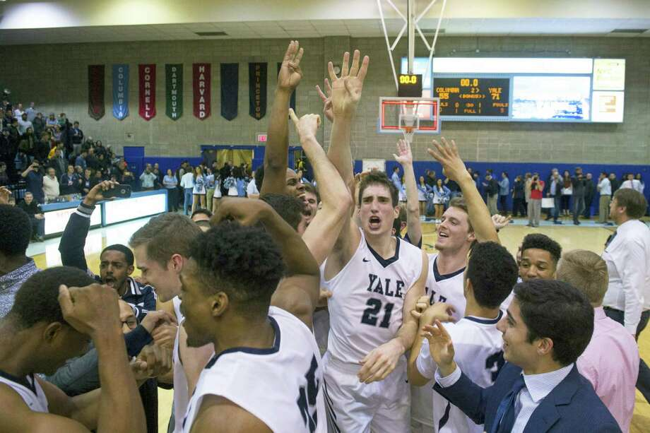 Yale guard Nick Victor (21) celebrates the win at the end of the second half of an NCAA Ivy League Conference college basketball game Saturday, March 5, 2016, in New York. Yale beat Columbia 71-55. (AP Photo/Bryan R. Smith) Photo: AP / FR171336 AP