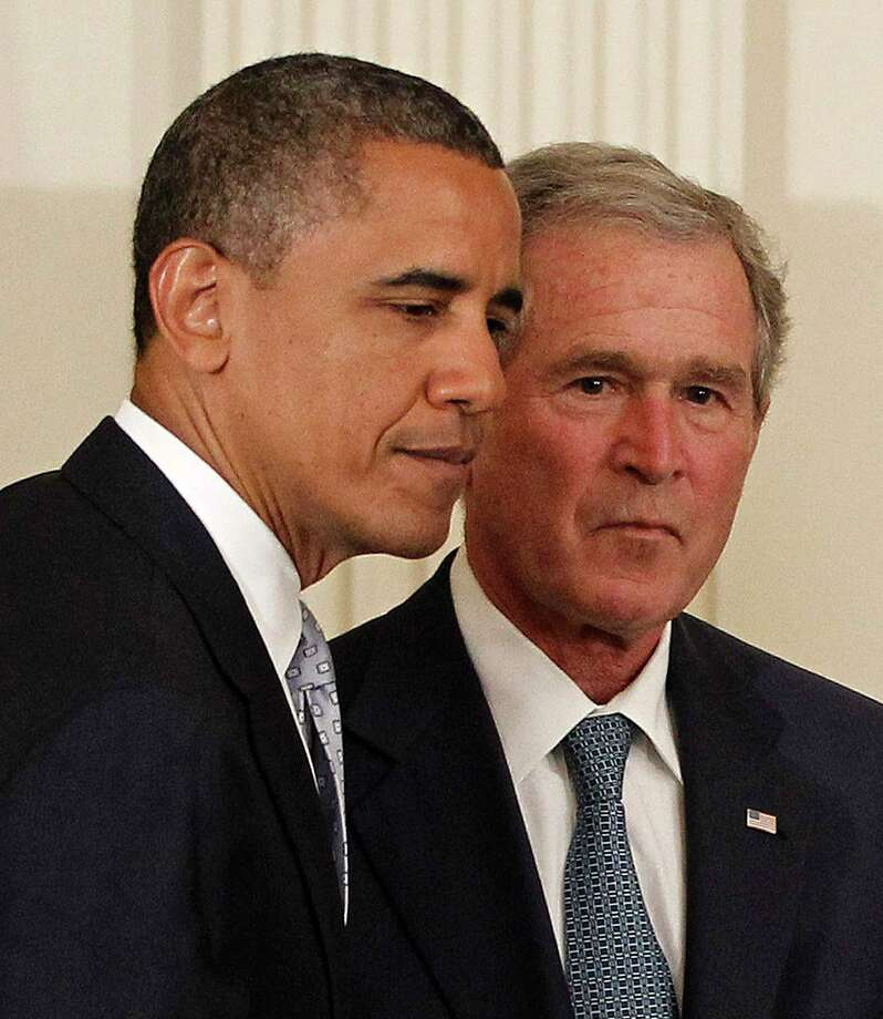 """FILE - In this Thursday, May 31, 2012, file photo, President Barack Obama and former President George W. Bush take part in a ceremony in the East Room of the White House in Washington, to unveil the Bush portrait. Taunted by Republicans to declare war on """"radical Islamic terrorism,"""" Democrats are turning to an unlikely ally: George W. Bush. Obama, under pressure to be more aggressive on terrorism, regularly cites his predecessor's refusal to demonize Muslims or play into the notion of a clash between Islam and the West. It's a striking endorsement from a president whose political rise was predicated on opposition to the Iraq war and Bush's hawkish approach in the Middle East. Photo: AP Photo/Pablo Martinez Monsivais, File / AP"""